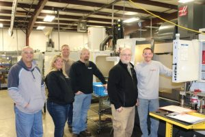 The team from Torque Tools watches machinist Doug Smith verify settings on Haas CNC machine. From Left (photo by Deveron Milne) TTI Quality Manager Mike Smith, TTI Accountant/Quality Control Shelly Wedward, IBT Production Manager Roddy Ferrell, TTI General Manager Bobby Branam, IBT Quality Manager Bob Keller, IBT machinist Doug Smith.